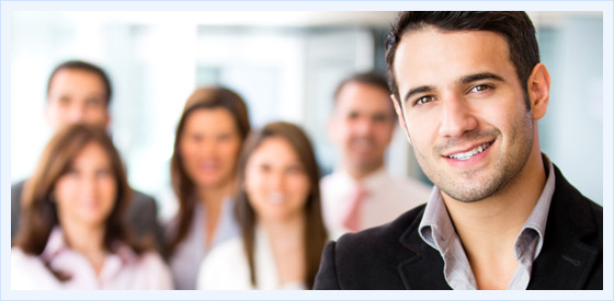 Man Sharing Office with Business Pros