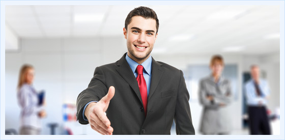 Young Business Man Holding Hand Out